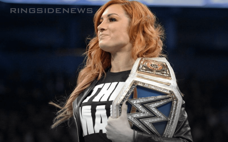 Becky-Lynch-Holding-Title