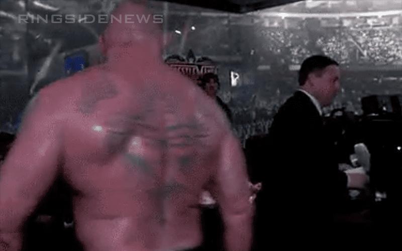 Brock-Lesnar-tosses-title
