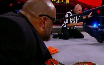 Taz Defends Decision To Throw In The Towel During AEW Title Match